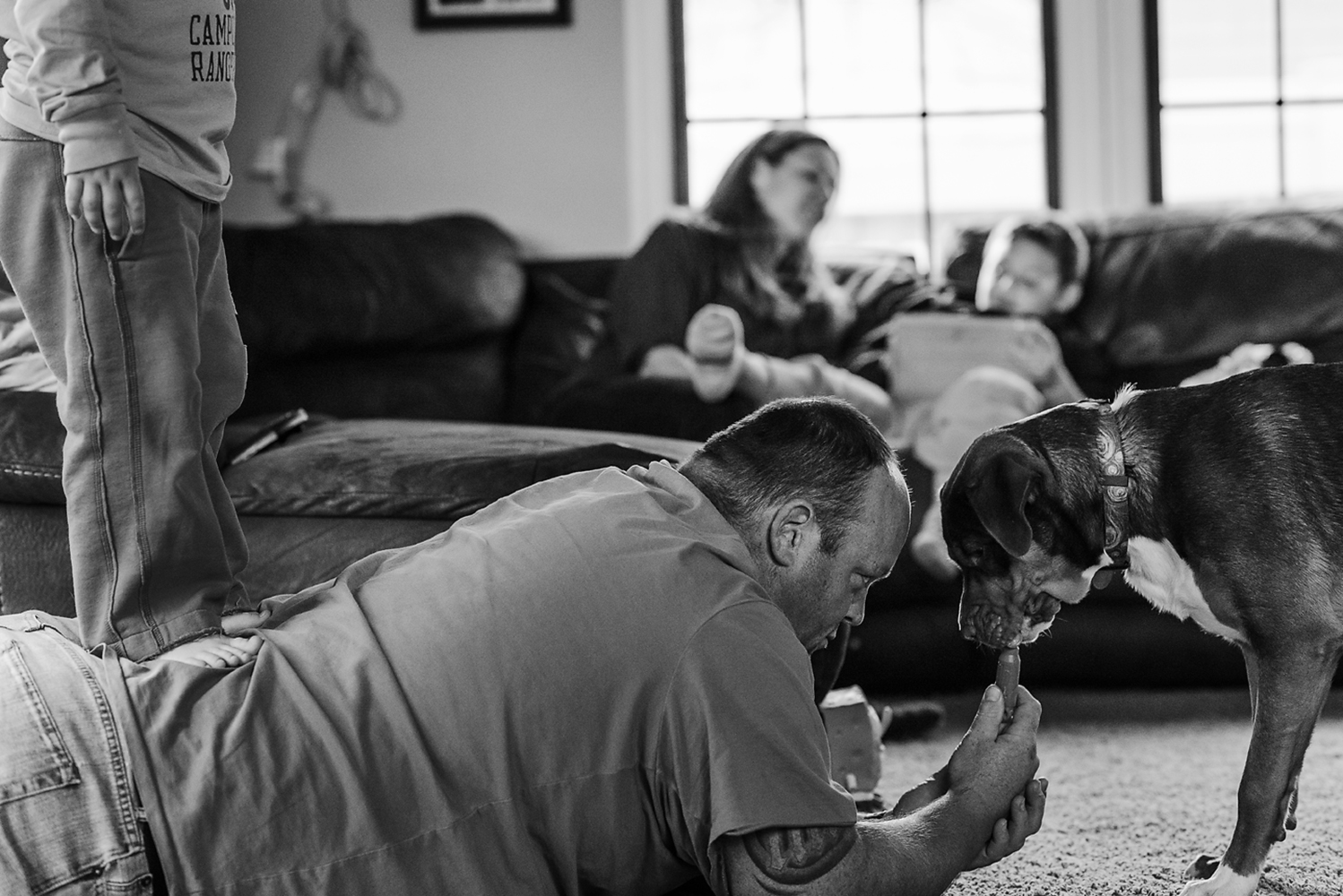 family lounging in the den