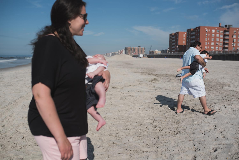 family leaving the beach in long beach ny