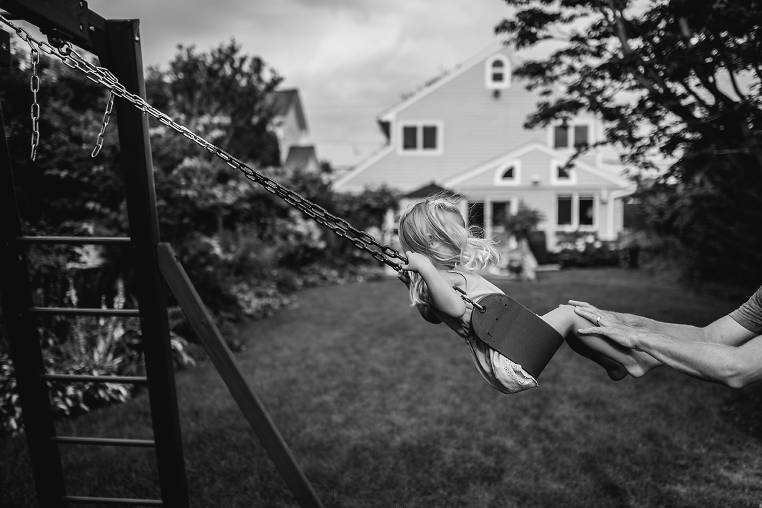 little girl swinging with daddy