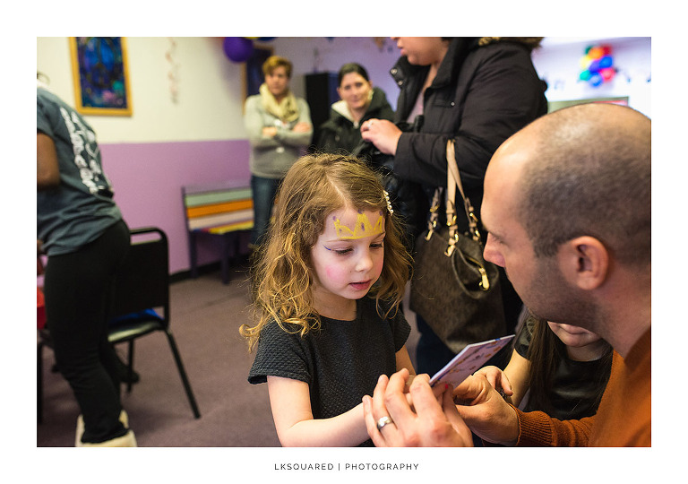little girl and her dad at a birthday party