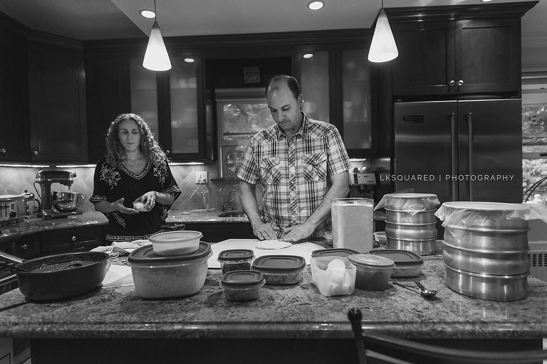 mom and dad prepping pizza