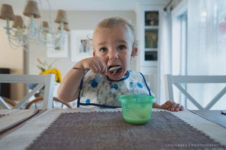 toddler eating yogurt for breakfast