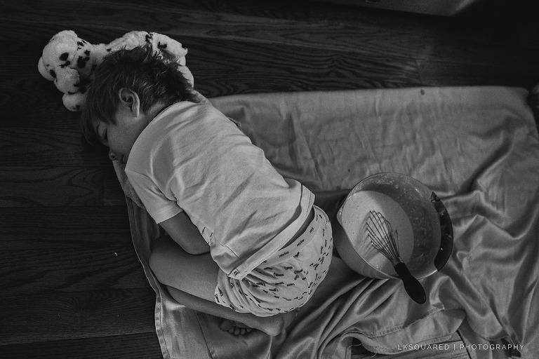 Long Beach Family Photography of boy sleeping on the kitchen floor