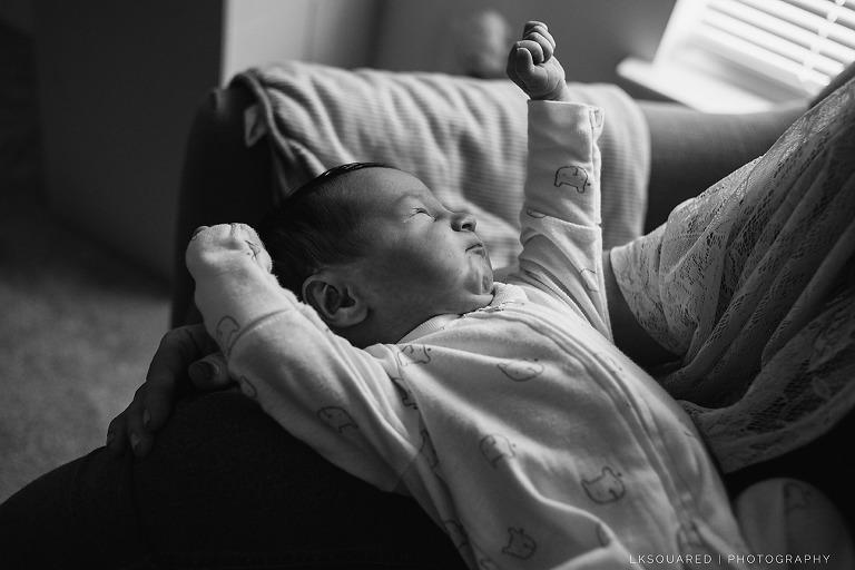 newborn baby girl stretching