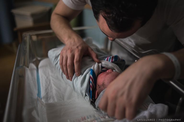 dad admiring and adoring his newborn son