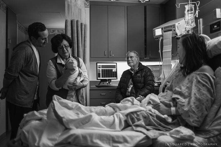 family meeting their new grandson for the first time