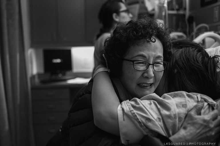 mom hugging her daughter after childbirth