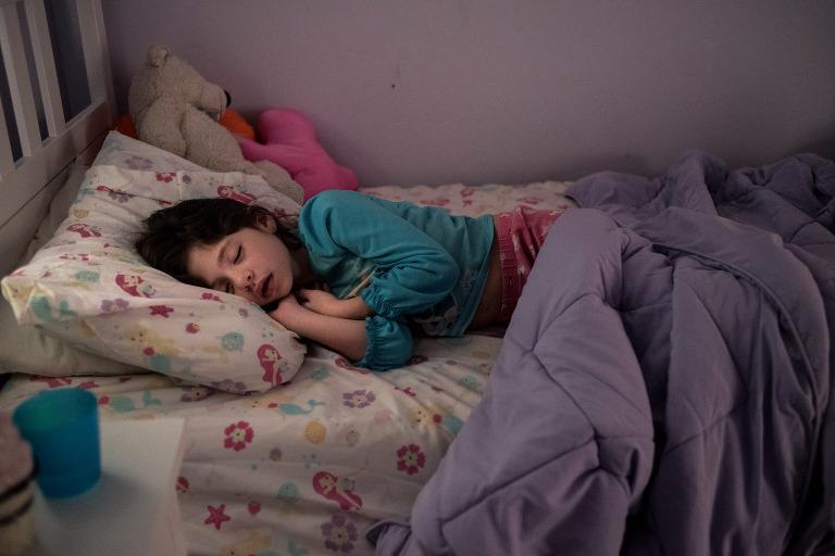 little girl asleep in the morning