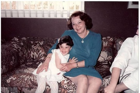 lauren with grandma on the couch in our first home in atlantic beach, ny