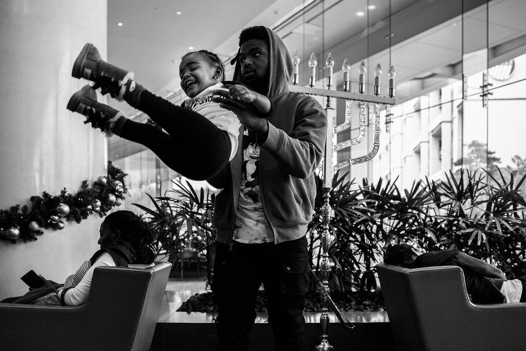big sister playing in the lobby with uncle